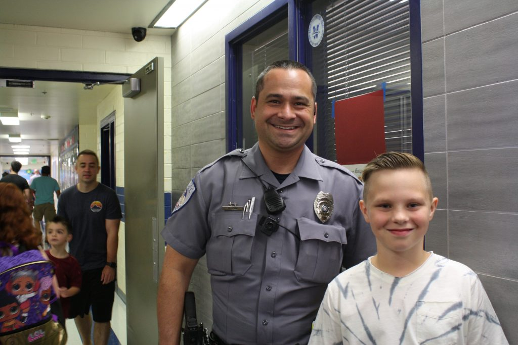 Officer visiting with student on first day