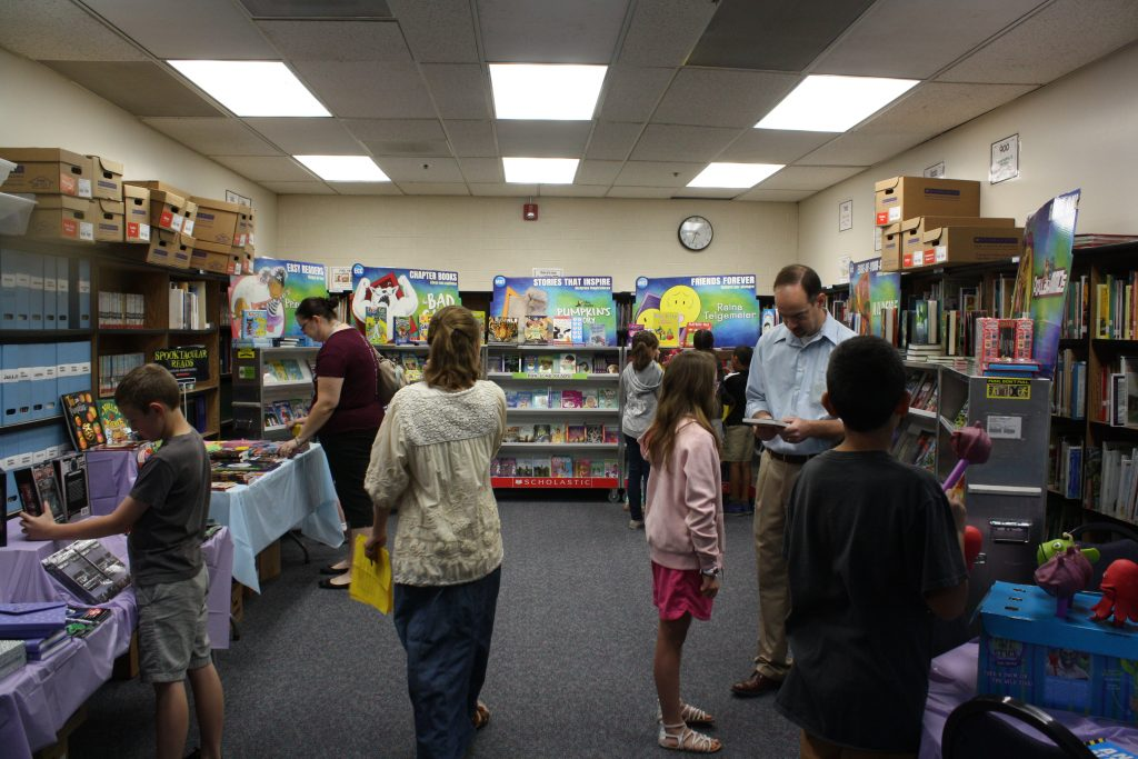 Students and parents checking out books in bookfair