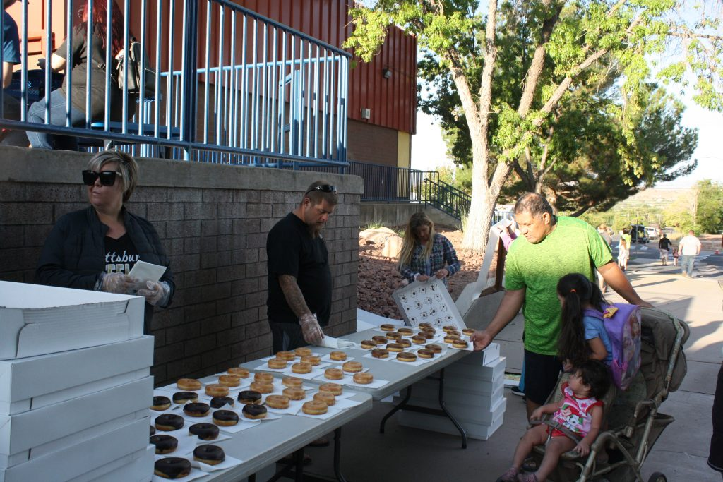 PTA handing out donuts to students and parents